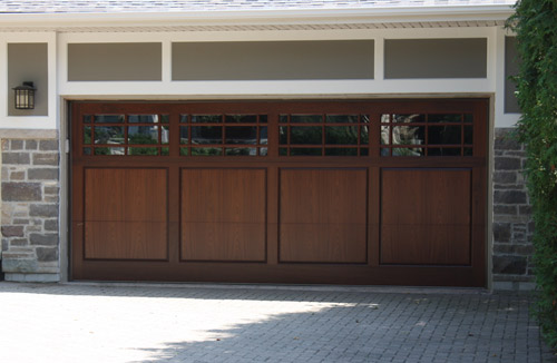 Custom wood doors offer by B & M Garage Door Inc