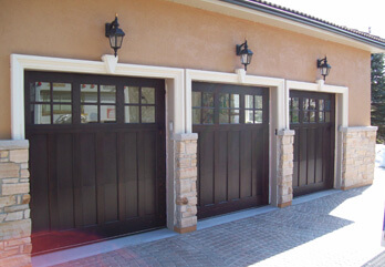 Three Dark Custom Wood Doors - With Windows
